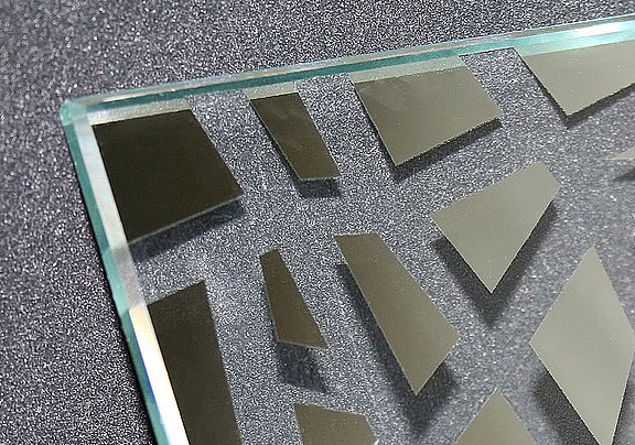 Clear glass optics by laser decoating